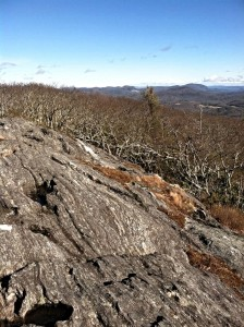 Heavily eroded rock summit of Yellow Mountain NC with panoramic views of surrounding mountains